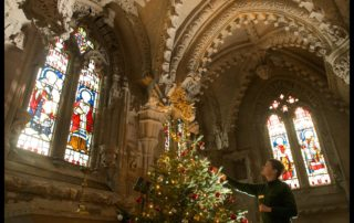 MANDATORY CREDIT - PIC: ROB MCDOUGALL  Guide Karolina Czekaj adds the finishing touches to the Christmas tree at Rosslyn Chapel, which was founded in 1446, and is still a working church as well as one of Scotland's most popular attractions. The Chapel, in Midlothian,  is open to visitors over the holidays and will host special services including on Christmas Eve and Christmas Day. Further details and opening times from www.rosslynchapel.com   MORE INFO: Ian Gardner Director Rosslyn Chapel Trust Tel. 0131 440 2159   ROB MCDOUGALL - PHOTOGRAPHER 07856 222 103  info@robmcdougall.com www.RobMcDougall.com